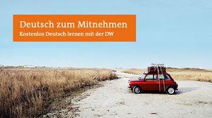 Auto in Landschaft und Aufschrift Deutsch zum Mitnehmen