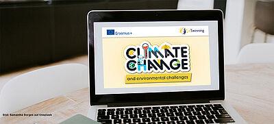 "Laptop mit dem Logo des Jahresthemas ""Climate Change"""