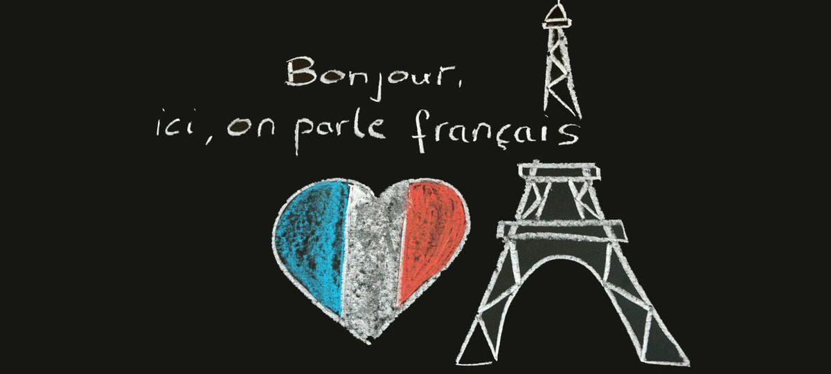 Tafel mit Eifelturm und Aufschrift Bonjour, ici, on parle francais