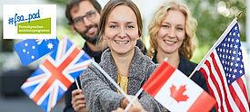 Junge Erwachsene mit USA-Flagge und weiteren Länderfahnen